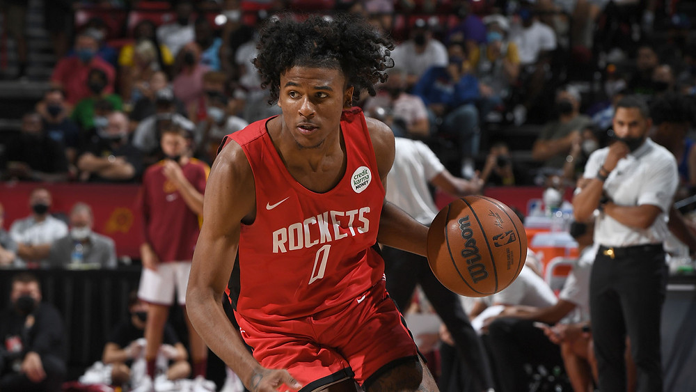 Houston Rockets shooting guard Jalen Green drives with the basketball on offense during an NBA Summer League basketball game.