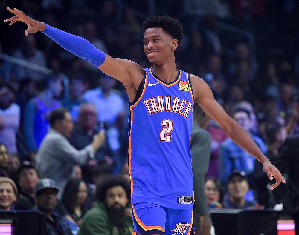Oklahoma City Thunder guard Shai Gilgeous-Alexander points to the crowd during an NBA basketball game.