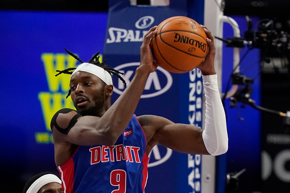 Detroit Pistons small forward Jerami Grant grabs a defensive rebound for his team during an NBA basketball game.