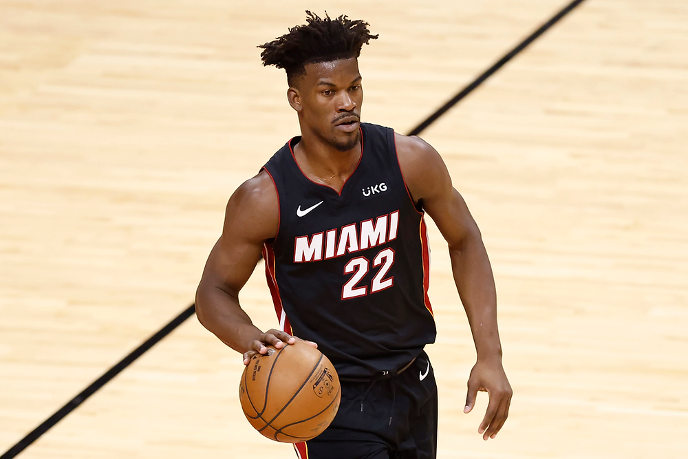 Miami Heat small forward Jimmy Butler prepares to initiate a play during an NBA basketball game.