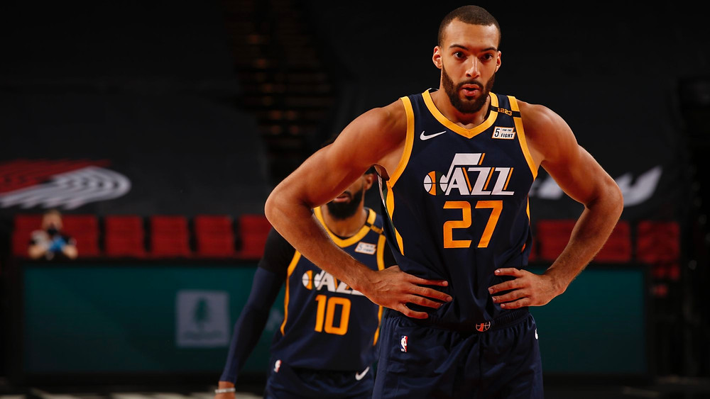 Utah Jazz center Rudy Gobert waits for the basketball at the free throw line during an NBA basketball game.