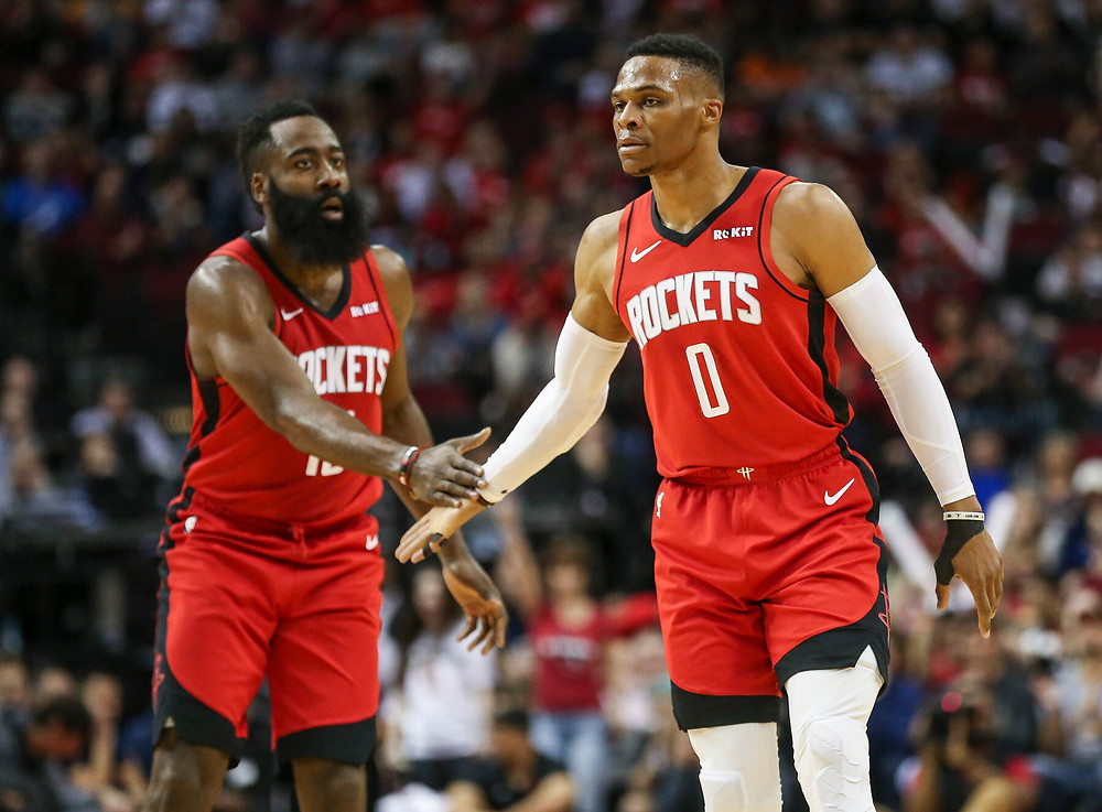 James Harden and Russell Westbrook of the Houston Rockets high-five during an NBA basketball game.