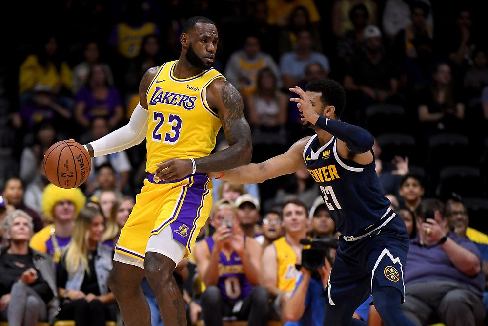 Point guard Jamal Murray of the Denver Nuggets guards small forwards LeBron James of the Los Angeles Lakers in Game 1 of the NBA Western Conference Finals.