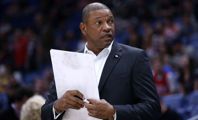 Head coach Doc Rivers of the Los Angeles Clippers draws up plays for his team in an NBA game.