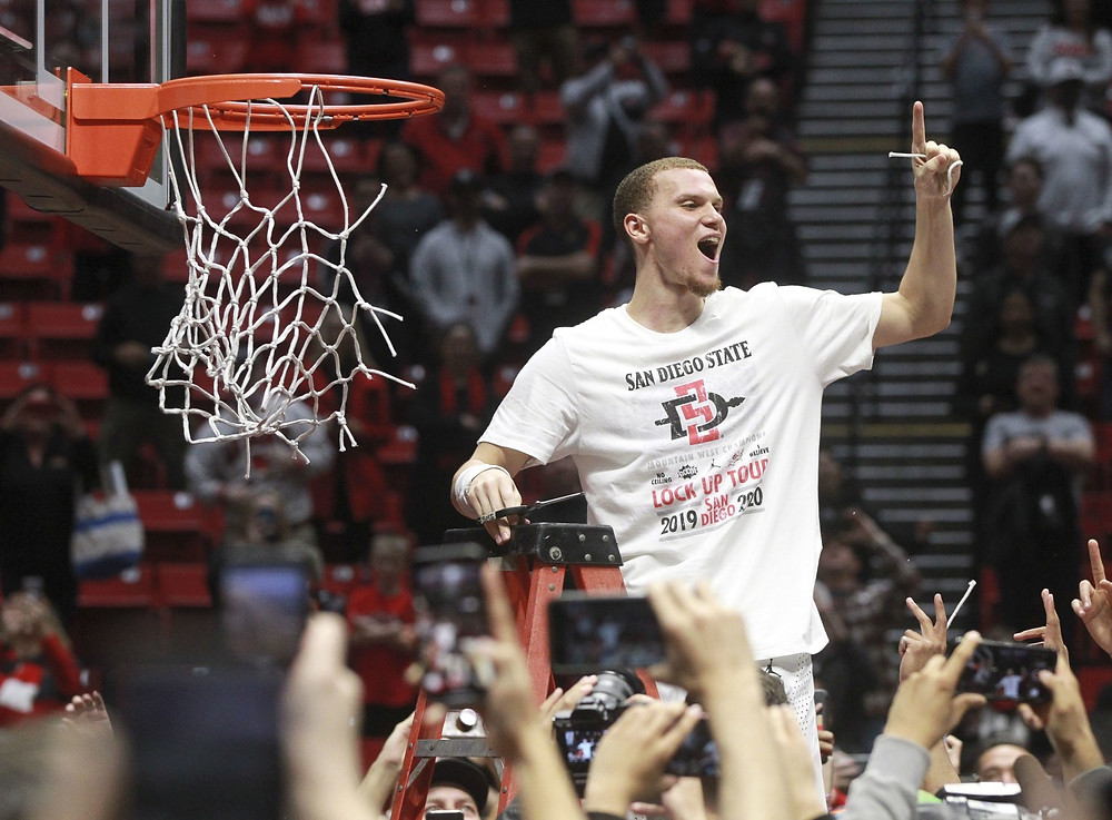 San Diego State Aztecs point guard Malachi Flynn cuts the net and celebrates after defeating New Mexico to clinch the Mountain West title.