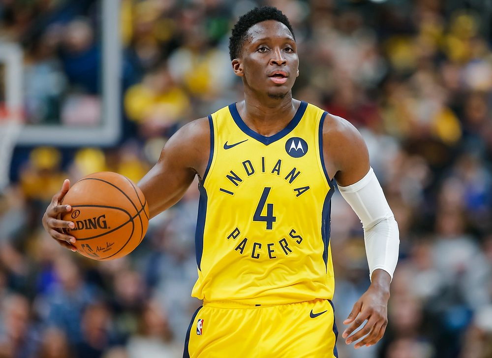Houston Rocket Victor Oladipo, formerly on the Indiana Pacers, dribbles the ball up the court during an NBA basketball game.
