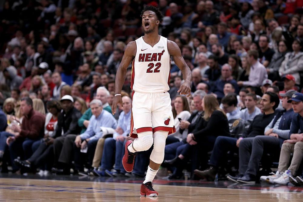 Miami Heat shooting guard Jimmy Butler celebrates following a made basket in an NBA basketball game.