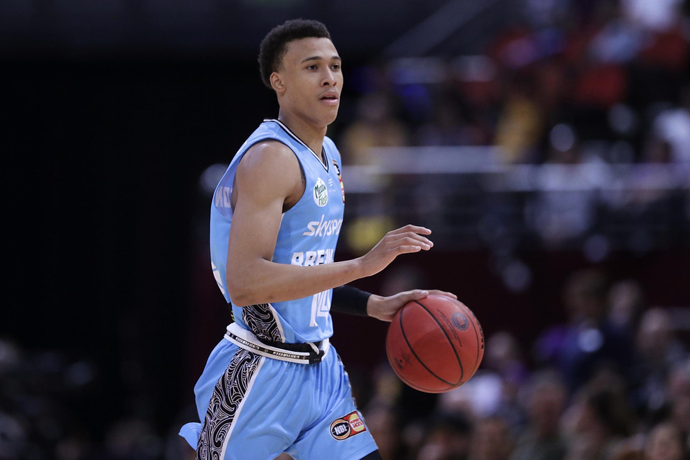 New Zealand Breakers guard RJ Hampton brings the ball up to half-court during an NBL basketball game.