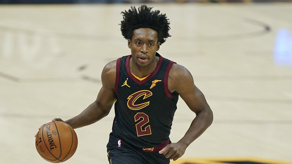 Cleveland Cavaliers guard Collin Sexton dribbles the ball up the court on offense during an NBA basketball game.