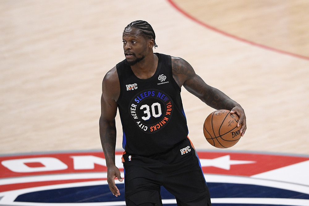New York Knicks forward Julius Randle dribbles the ball up the court on offense during an NBA basketball game against the Washington Wizards.