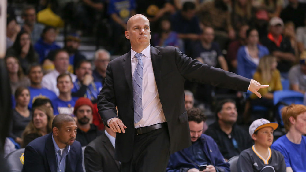 Raptors assistant coach Nate Bjorkgren points something out in an NBA basketball game.