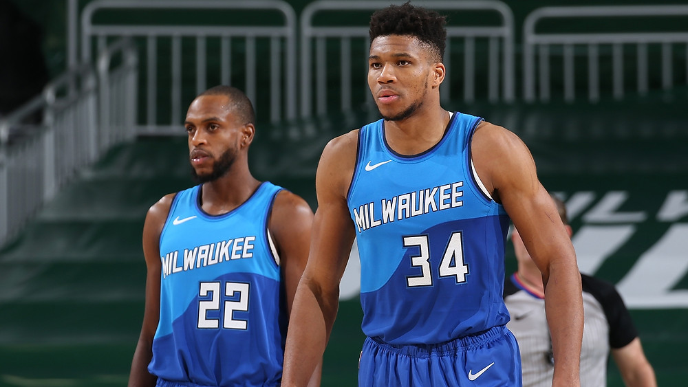 Khris Middleton and Giannis Antetokounmpo prepare for a play during an NBA basketball game.