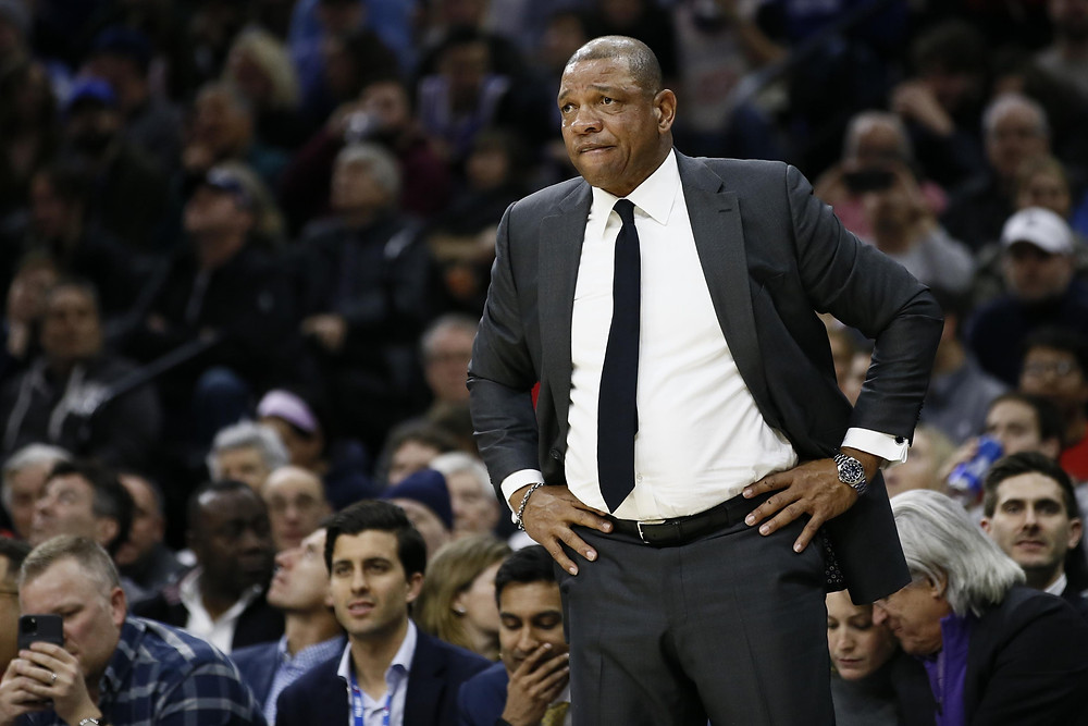 Los Angeles Clippers head coach Doc Rivers looks at his team in an NBA basketball game.