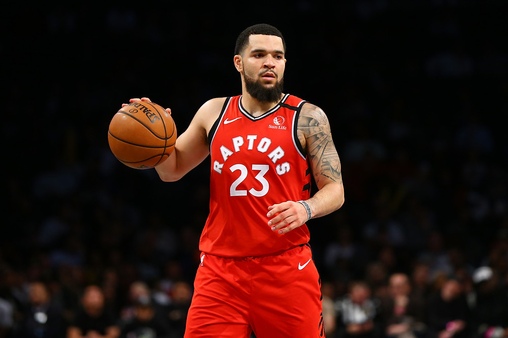 Toronto Raptors point guard Fred VanVleet dribbles the basketball up the court in an NBA basketball game.