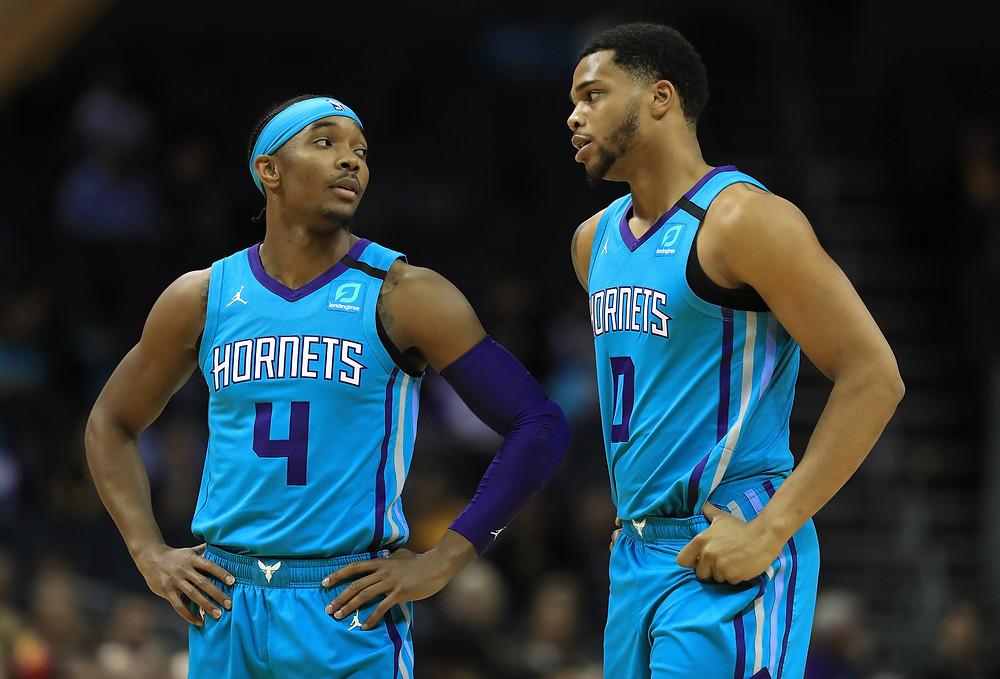Charlotte Hornets stars Devonte' Graham and Miles Bridges discuss during an NBA basketball game.
