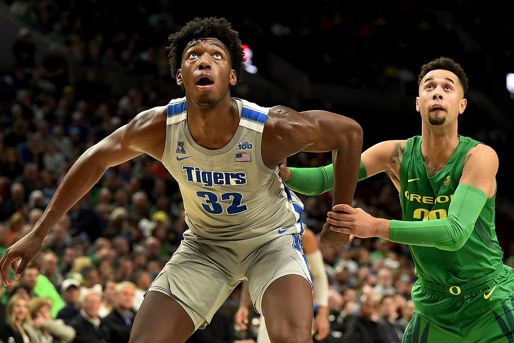 James Wiseman of the Memphis Tigers battles Anthony Mathis of the Oregon Ducks for a rebound.
