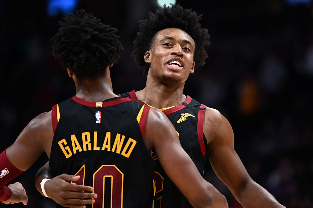 Cleveland Cavaliers guards Collin Sexton and Darius Garland embrace after a made basket during an NBA basketball game.