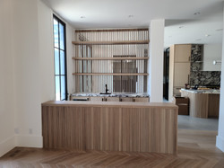 Wet bar with slatted white oak wall