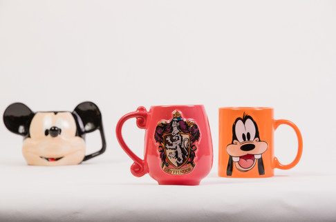 Disney Mickey Mouse, Griffindor, and Goofy mugs