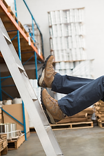 stock-photo-worker-falling-off-ladder-in