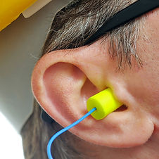 stock-photo-yellow-earplug-into-the-ear-
