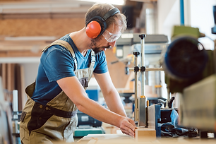stock-photo-absorbed-carpenter-with-ear-