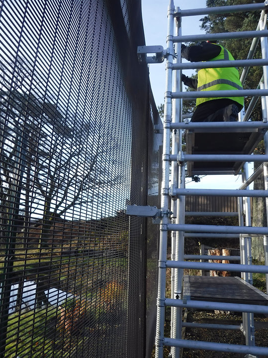 QAB Brackets securing access tower to 358 mesh fence