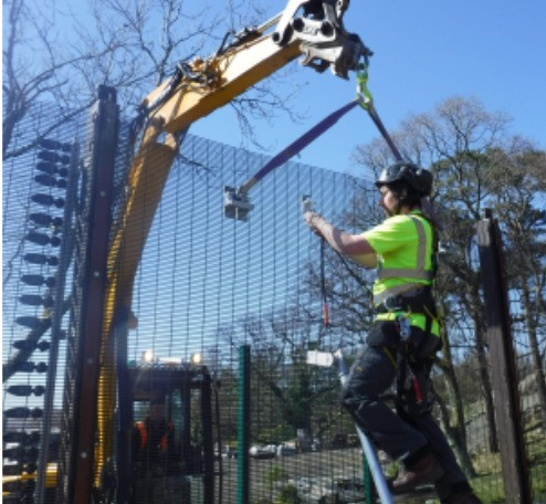 User working safely at height using QAB equipment for installation and maintenance purposes.
