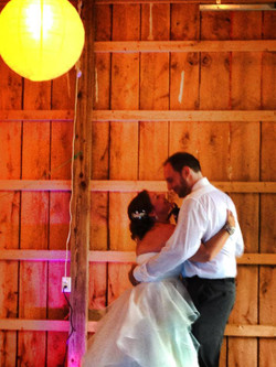 Rustic lighting with Bride and Groom