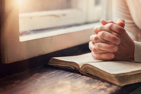 Bible, praying hands