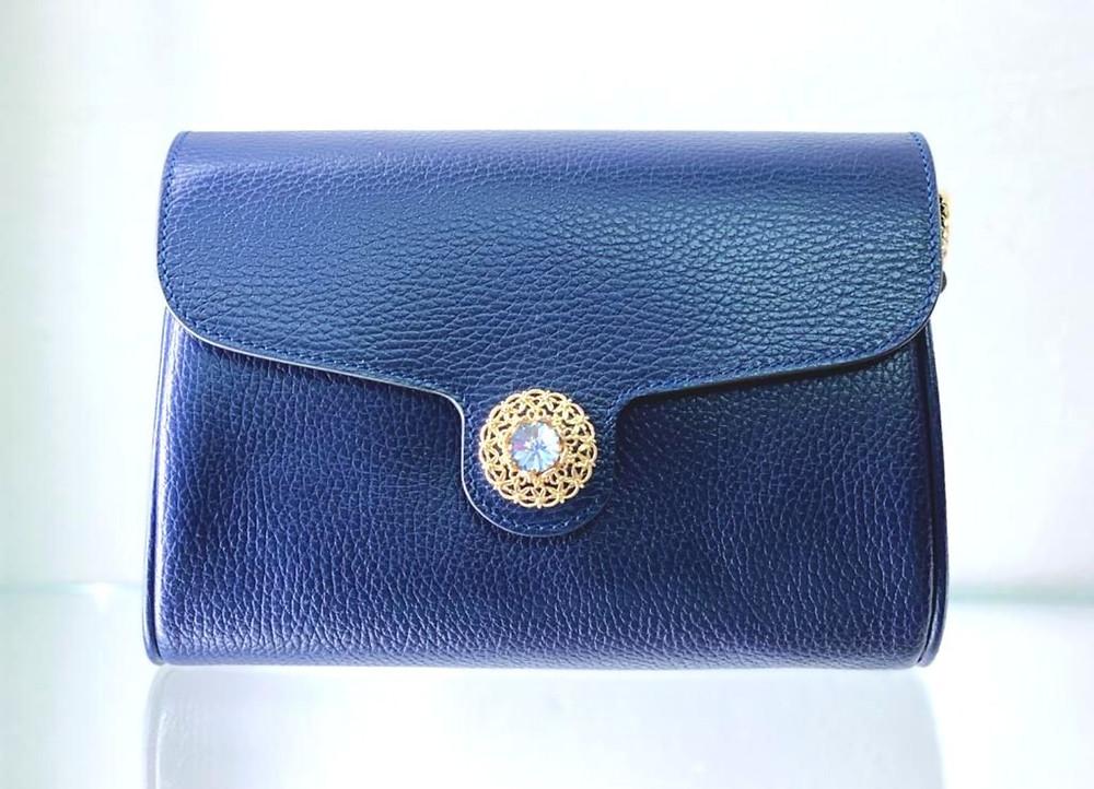Lucrezia proposal in Blu Dollaro genuine leather clutch with jewel