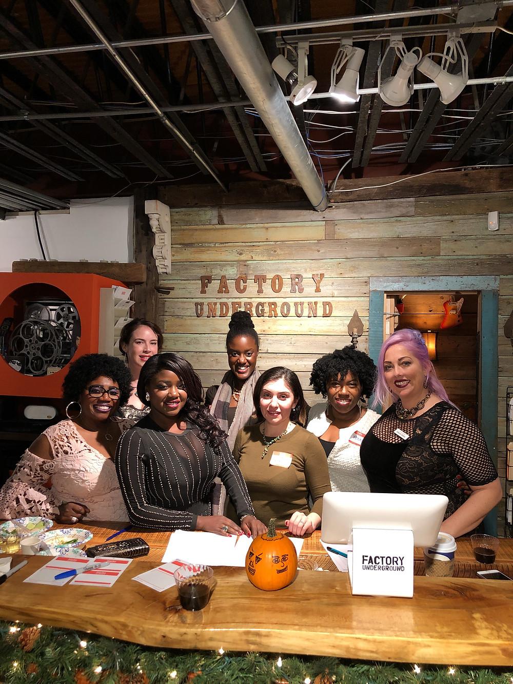 Event organizer, Katia Garcon, and friends manning the front desk at Factory Underground Studio