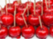Beautiful tasty red candy apples on a table..jpg