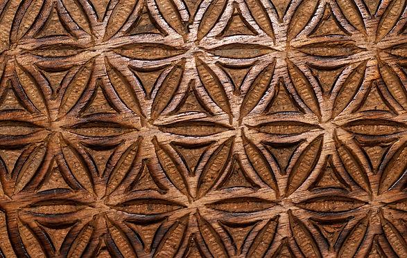 wooden flower of life sign texture backg