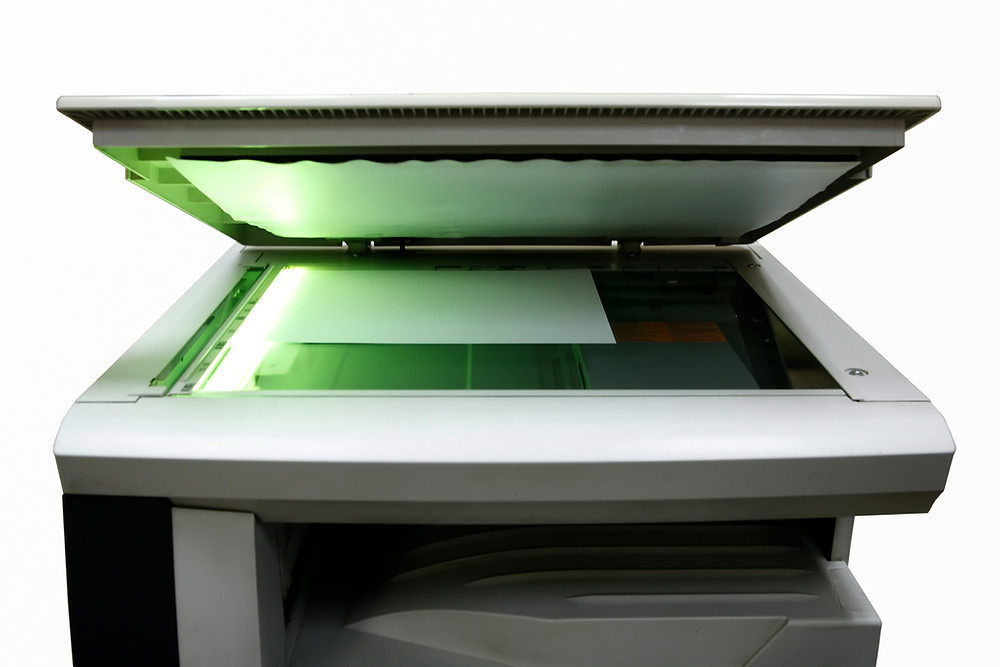 Digital Clean-Up Tips - Scanner/copier with paper on bed