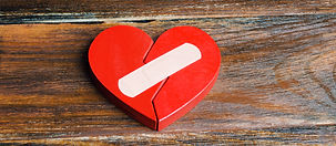 A red heart with a plaster. Renewal of t