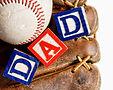 baseball in an old baseball glove with t
