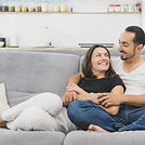happy couple hugging on the couch at home and relaxing togetherness.jpg