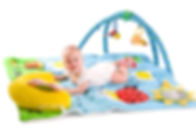Happy baby playing in baby gym toy, isol