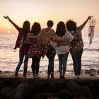 Dreaming image with group of females friends hug each other all together looking the sunse