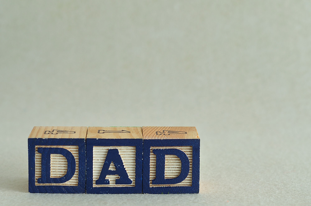 """Dad"" spelled in blocks"