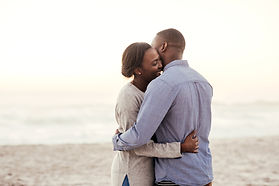 Young African woman hugging her partner