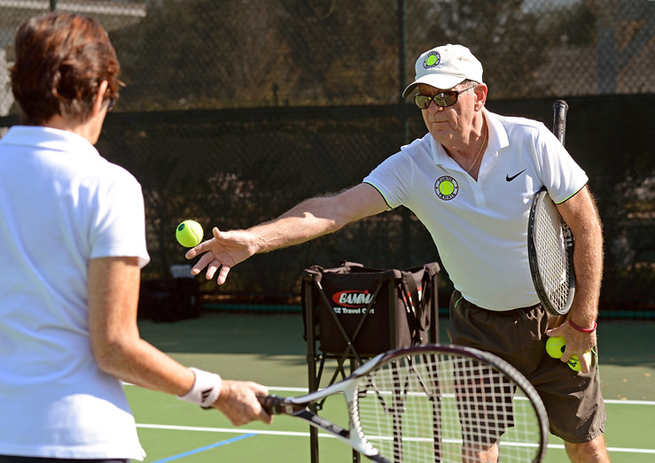 Teaching tennis lessons by Ed Curtis of Curtis Tennis