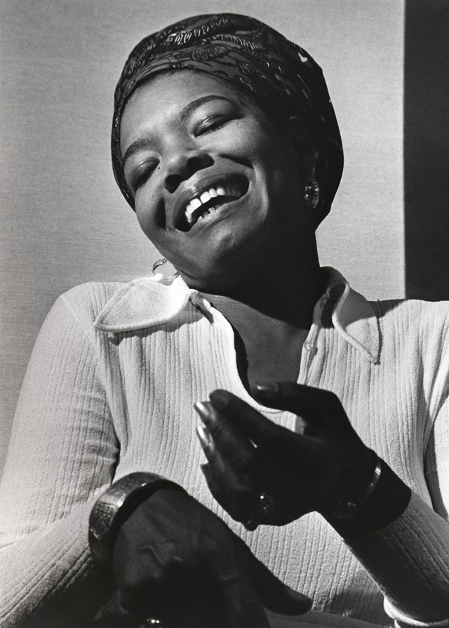 Maya Angelou head tilted to the side. Her eyes are close and she's laughing!