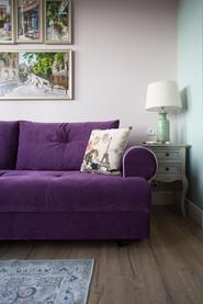 purple sofa in the studio by Albina Alieva