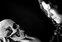 Actress Gigi Burgdorf looks at a skull