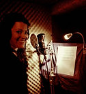Voiceover and actress Gigi Burgdorf in the recording booth