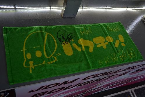 green signed URAS neck towel
