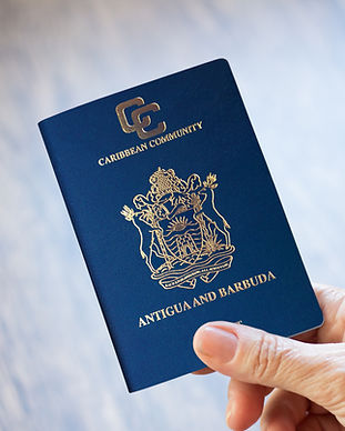 hand holding Antigua and Barbuda passpor