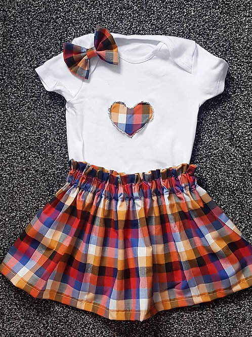 Girls vest, skirt, and bow set, chequed